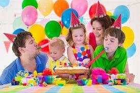 picture of celebrate  - Happy family celebrating kids birthday - JPG