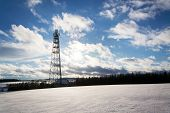 Snowy Winter Country With Transmitters And Aerials On Telecommunication Tower poster