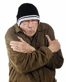 pic of shivering  - A senior man in ski cap and thin jacket shivering from the cold - JPG