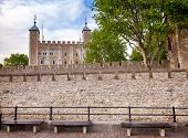 The outer curtain wall and the White Tower of the Tower of London  - historic castle and popular tou poster