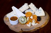 picture of penicillium  - A cheese platter featuring blue vein and camembert cheeses dired fruits kiwi fruit - JPG