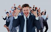 large business team celebrating success with arms raised isolated against white background. poster