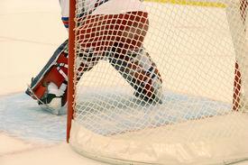image of gatekeeper  - Details ice hockey gatekeeper and hockey net - JPG