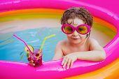 Relax In Spa Swimming Pool. Happy Little Boy Relaxing In Pool. Little Child Boy Having Fun In The Po poster