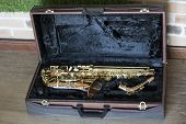 Expensive Saxophone In A Velvet Case.musical Expensive Instrument poster