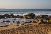 Waves Breaking On Rocky Beach On Durban Coastline poster