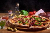 Delicious Italian Pizza Served On Wooden Table. Sliced Pizza. Tasty Pizza Composition poster
