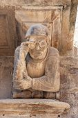 stock photo of corbel  - Man with glasses in a baroque building Cervera Catalonia Spain - JPG