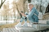 Aging Smiling Charming Woman Engaging In Photography In The Park poster