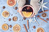 Female Hands Holding Cup Aromatic Mulled Wine With Spices And Orange Slices Flat Lay Copyspace Photo poster