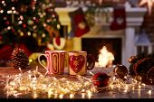 Christmas still life with mugs and fireplace - cosy winter time. poster