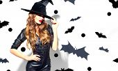 Halloween Sexy Girl wearing witch costume with a hat and Black leather dress. Party, Celebrating. Be poster