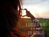 Inspirational Motivational Quote - A Grateful Heart Is A Magnet For Miracles. With Woman Making Hear poster