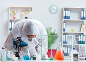 Scientist doing animal experiment in lab with rabbit poster