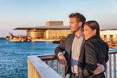 Europe travel tourists couple enjoying sunset view at Copenhagen harbourfront by the Opera, Denmark  poster
