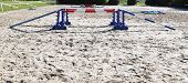 Colorful Barriers On The Ground For Jumping Horses And Riders At Riding School As A Background.obsta poster