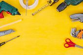 Do It Yourself Tools On Yellow Background. Diy Tools With Copy Space For Text On Yellow Wooden Backg poster