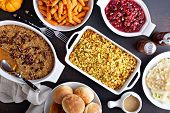 Variety Of Thanksgiving Sides On The Dinner Table, Carrots, Mashed Potatoes, Sweet Potato Casserole  poster