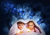 Scared Sister And Brother With Flashlights Hiding Under Blanket From Nightmare Monsters. Frightened  poster