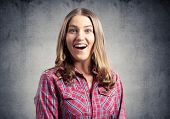Happy Charming Girl Smiling Wide. Emotional Young Woman Has Surprised Facial Expression. Portrait Of poster