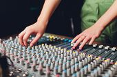 The Mixer. Remote For Sound Recording. Sound Engineer At Work In The Studio. Sound Amplifier Mixing  poster