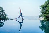 Beautiful Woman Practice Yoga Pose On The Infinity Pool Above The Mountain Peak In The Morning In Fr poster