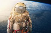 Cosmonaut Or Astronaut Or Spaceman In Helmet At Earth Background View From Outer Space. Elements Of  poster