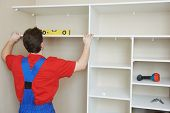 carpenter worker joint and settle home built-in cupboard