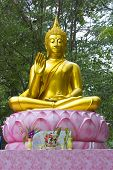 stock photo of scruple  - The buddha statue at temple park outdoor - JPG