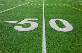 pic of ncaa  - fifty yard line - football field