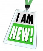 The words I Am New on a green badge and lanyard to help a recently hired employee meet co-workers or