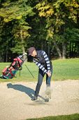 picture of ladies golf  - Female golf player put golf ball in sand - JPG