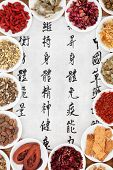 Traditional chinese herbal medicine with mandarin script calligraphy on rice paper. Translation desc