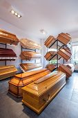 stock photo of funeral home  - Wooden brown coffins in a funeral home - JPG