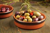image of kalamata olives  - Varitey of olives into into bowls on wooden table - JPG