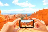 Smartphone taking photo of Bryce Canyon nature. Close up of mobile phone camera screen photographing