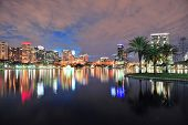 picture of skyscrapers  - Orlando downtown skyline over Lake Eola at dusk with urban skyscrapers and lights - JPG