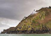 picture of sark  - Coastal scene on Sark with a Lighthouse - JPG