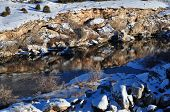 stock photo of breath taking  - Mirrored river in the Mountain of Wyoming - JPG