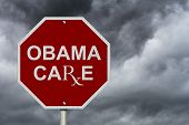 picture of mandate  - Stop ObamaCare Sign An American road stop sign with word ObamaCare with a stormy sky background - JPG