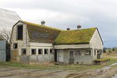 foto of dairy barn  - An abandoned dairy barn and milk house in rural Washington state - JPG