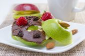 pic of bagel  - Green apple bagel served on white plate with strawberry - JPG