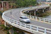 Traffic concept: car driving fast through a sharp turn