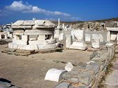 image of phallus  - Stone ruins and parts of sculptures outside on island Delos near Mykonos - JPG