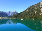 A boat cruising along the Achensee Lake in Tirol, Austria, Central Europe