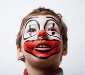 foto of pantomime  - little cute boy with facepaint like clown - JPG