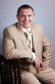 foto of woohoo  - Positive business man  in a light suit - JPG