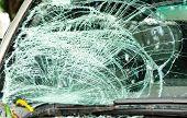 foto of typhoon  - broken car windshield of car by typhoon - JPG