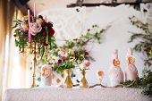 stock photo of wedding feast  - Floral arrangement to decorate the wedding feast the bride and groom - JPG