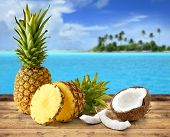 stock photo of tropical food  - fresh pineapple and coconut in tropical landscape - JPG